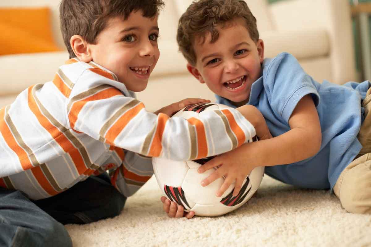 boys playing on carpet