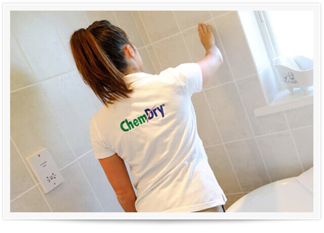 woman cleaning wall tile